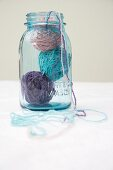 Three balls of wool in glass jar