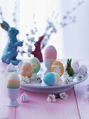 Easter arrangement with dyed Easter eggs & rabbit ornaments