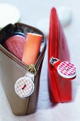 Make-up bags with zips decorated with buttons