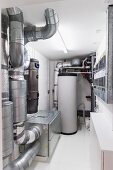 Domestic technology room with various installations and piping systems