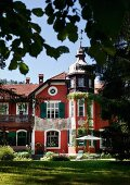 Sun shining on restored facade of manor house in southern German