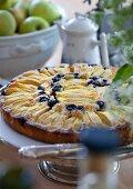 Apple tart with blueberries