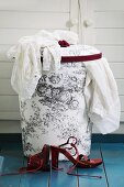 Laundry basket with hand-sewn, toile de jouy fabric cover