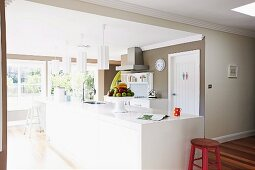 Open kitchen with white kitchen unit and fruit bowl