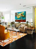 Lounge area with yellow reading chair and sofa around white coffee table on white and orange patterned rug in open-plan interior