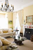 Upholstered set with coffee table and fireplace in the living room with yellow walls