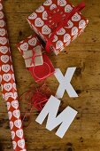 Christmas gift wrapped in red and white wrapping paper