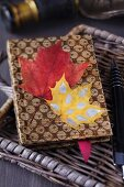 Notebook decorated with autumn leaves