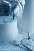 Small figurines skiing on sugarloaf mountains