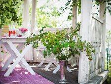 Twigs in vase in pavilion
