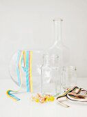 Glass vessels, decorative ribbons & glass sphere for creating flower arrangements