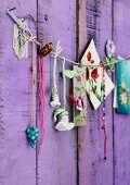 Crocheted flowers, beads and pictures of flowers pegged on cord