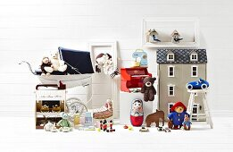Toy still life with gray doll's house and nostalgic prams