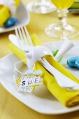 Flower shape punched out of map as name tag on place setting