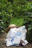 Straw hat on hand-sewn beach bag and cosmetics bag made form striped fabric