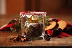 Hand-crafted candle lantern with festive spices