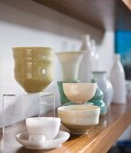 Select collectors' items - vases and bowls on wooden shelf
