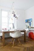 Desk, classic chair and Zettel'z chandelier in front of window