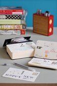 Tear-off calendar and pocket calendar with handwritten notes
