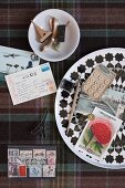Collection of craft utensils, nostalgic postage stamps, postcards, buttons and stamps