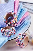 Wooden napkin rings decorated with colourful confetti