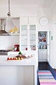 Island counter in modern, white kitchen