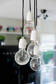 Pendant lamps ending in simple light bulbs