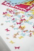 Colourful, butterfly confetti cut out using pattern punch