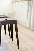 Classic metal stools on wooden kitchen floor
