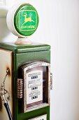 Vintage petrol pump against wall