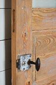 Detail of lock on rustic interior door