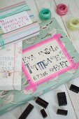 Vintage arrangement of wrapped gifts with hand-crafted address labels and black alphabet stamps