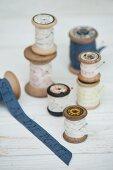 Vintage arrangement of printed ribbons on wooden reels