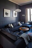 Comfortable sofa combination and classic coffee table in blue lounge area