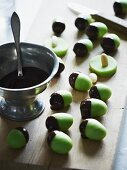 Green marzipan acorns with chocolate cups