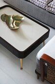Organically shaped gilt dish on fifties, retro-style tray table