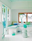 Corner bench and white table in corner of bright room in white and mint green