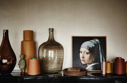 Ornaments; vintage vases, reels of thread, demijohn and oil painting