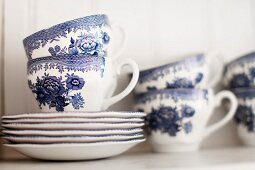 White tea service with blue painted pattern