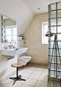 Vintage swivel stool under sink opposite glass brick shower cubicle in modern bathroom