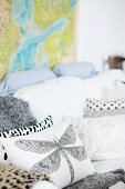Cushions with dragonfly motif and various patterns on white couch