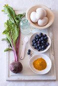 Natural dyes for dying Easter eggs - blueberries, turmeric and beetroot