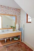 Modern washstand with framed mirror against exposed, vintage-style brick wall