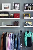 Modern dressing room - shirts hung on clothes racks, accessories on white shelves
