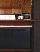 Designer kitchen with fronts in mixture of elegant materials