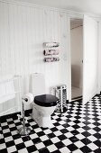 Chequered floor in rustic bathroom with white wood-clad walls