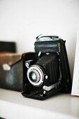 Antique camera on shelf
