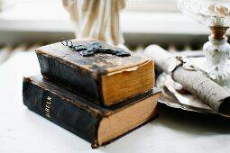 Cross pendant on sacked, antiquarian books