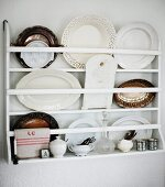 Decorative dishes and plates in wall-mounted plate rack
