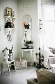 White, carved bracket shelves in corner and various small items of furniture against wall